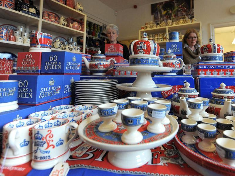 Pieces from the diamond jubilee collection are stacked up on sale at the Emma Bridgewater pottery in Hanley, Stoke on Trent, England. The diamond jubilee range will feature both hand decorated spongeware patterns and lithographed prints on celebratory mugs, bowls, plates, teapots and a ceramic crown emblazoned with the slogans 'Sixty Years a Queen' and 'Steadfast and True. AFP PHOTO / Andrew Yates