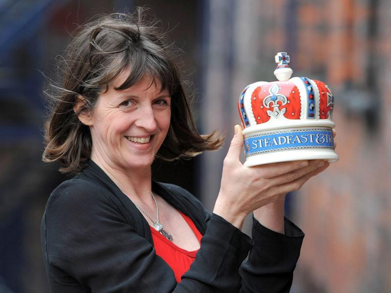 Emma Bridgewater of Emma Bridgewater pottery holds a crown shaped pot in Hanley, Stoke on Trent, England where the pottery is producing a collection to celebrate the queen's diamond jubilee. The Diamond Jubilee range will feature both hand decorated spongeware patterns and lithographed prints on celebratory mugs, bowls, plates, teapots and a ceramic crown emblazoned with the slogans 'Sixty Years a Queen' and 'Steadfast and True. AFP PHOTO / Andrew Yates