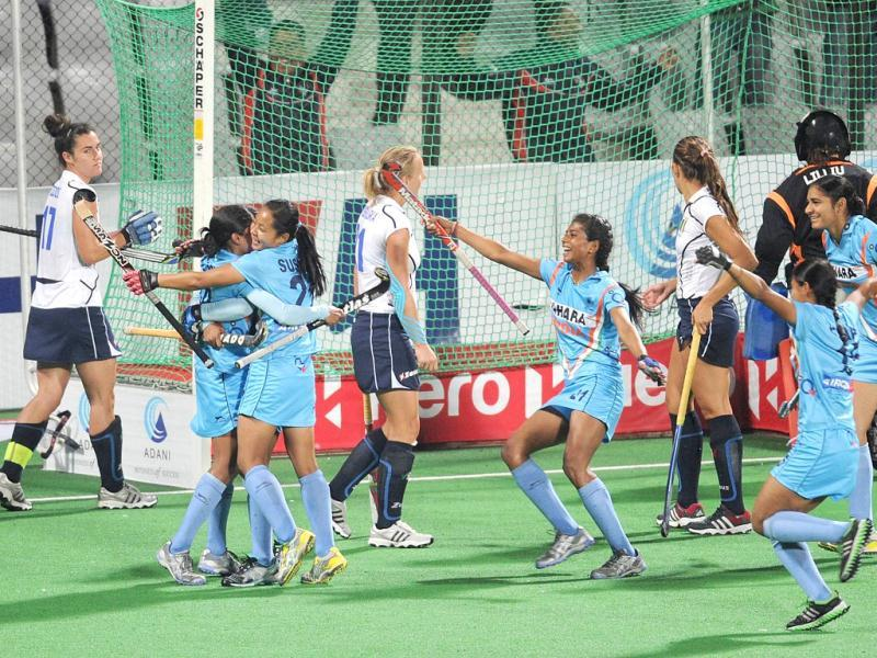 Ritu Rani (L) of India is congratulated by teammates after scoring a goal during the women's field hockey match between India and Italy of the FIH London 2012 Olympic Hockey qualifying tournament at the Major Dhyan Chand National Stadium in New Delhi. AFP PHOTO/Prakash Singh