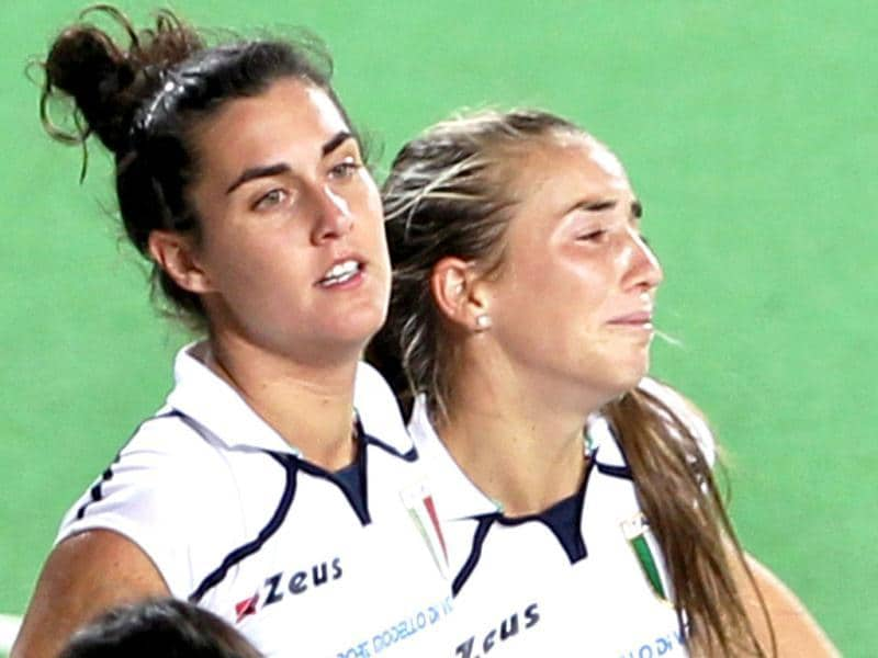Italy's Lovagnini Aldana (R) breaks into tears after losing their Olympic qualifier (women) hockey match against India in New Delhi. PTI Photo by Manvender Vashist