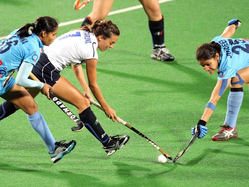 Ana Laura Bertarini (C) of Italy vies for the ball with Vandana Katariya (L) and Joydeep Kaur of India during the women's field hockey match between India and Italy of the FIH London 2012 Olympic Hockey qualifying tournament at the Major Dhyan Chand National Stadium in New Delhi. AFP PHOTO/Prakash SINGH