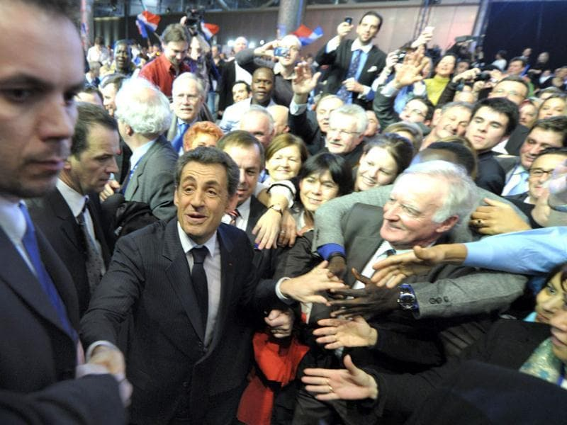 France's President and candidate for the 2012 French presidential elections Nicolas Sarkozy is cheered by supporters as he leaves a political rally in Lille. Reuters/Philippe Wojazer