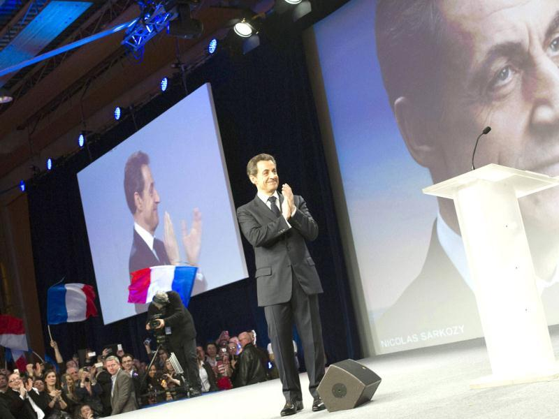 Nicolas Sarkozy, France's President and UMP party candidate for the 2012 French presidential election, reacts on stage after his speech at a campaign rally in Lille.  Reuters/Lionel Bonaventure/Pool