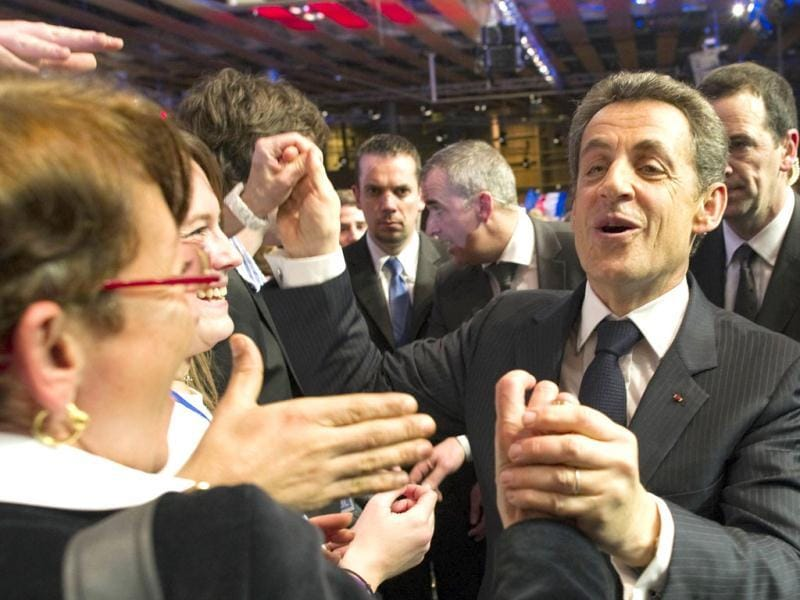 Nicolas Sarkozy (R), France's President and UMP party candidate for the 2012 French presidential election, shakes hands with supporters as he leaves after a campaign meeting in Lille. Reuters/Lionel Bonaventure/Pool
