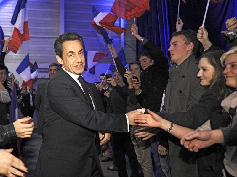 France's President Nicolas Sarkozy greets supporters as he arrives at his first major re-election campaign rally in Marseille, southern France. Reuters/Lionel Bonaventure/POOL