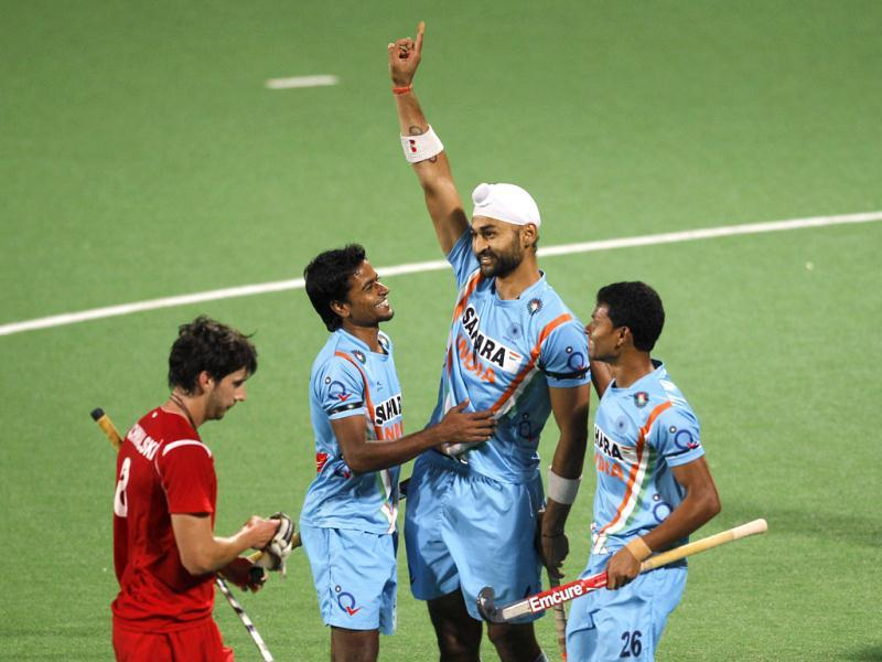 Indian players, Sandeep Singh, second right, Birendra Lakra, right, and Danish Mujtaba, third right, celebrate as Sandeep scores the fourth goal against Poland during field hockey Olympic qualifier in New Delhi, India. On the left is Polish captain Dariusz Rachwalski.(AP Photo/Saurabh Das)