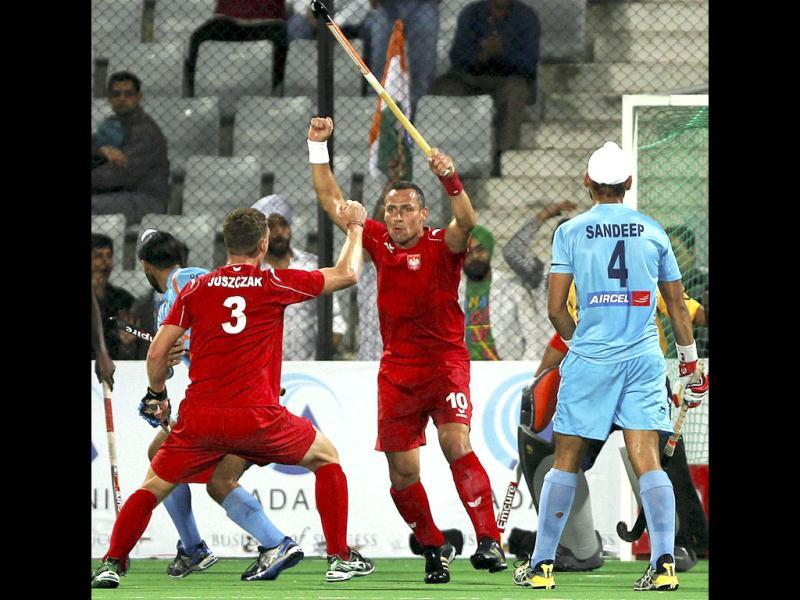 Poland's Tomasz Dutkiewicz (10) celebrates a goal against India during their Olympic qualifier (men) hockey match in New Delhi. PTI Photo by Aman Sharma