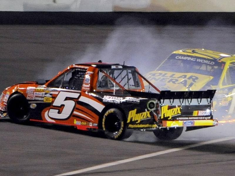 Jason Leffler (R) in his number 18 Toyota collides with Paul Harraka in his number 5 Ford during the NASCAR Camping World Series NextEra Energy Resources 250 truck race at the Daytona International Speedway in Daytona Beach, Florida. (Reuters)