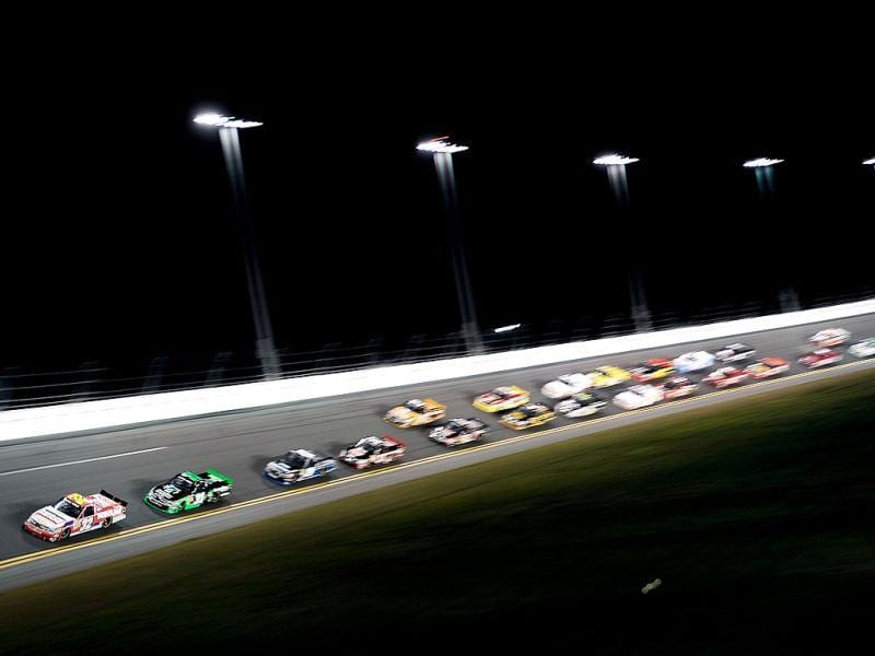 Miguel Paludo, driver of the #32 Duroline Brakes and Components Chevrolet, leads the field during the NASCAR Camping World Truck Series NextEra Energy Resources 250 at Daytona International Speedway in Daytona Beach, Florida. (AFP Photo)