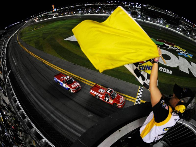 John King, driver of the #7 Red Horse Racing Toyota, takes the checkered flag under caution to win the NASCAR Camping World Truck Series NextEra Energy Resources 250 at Daytona International Speedway in Daytona Beach, Florida. (AFP Photo)
