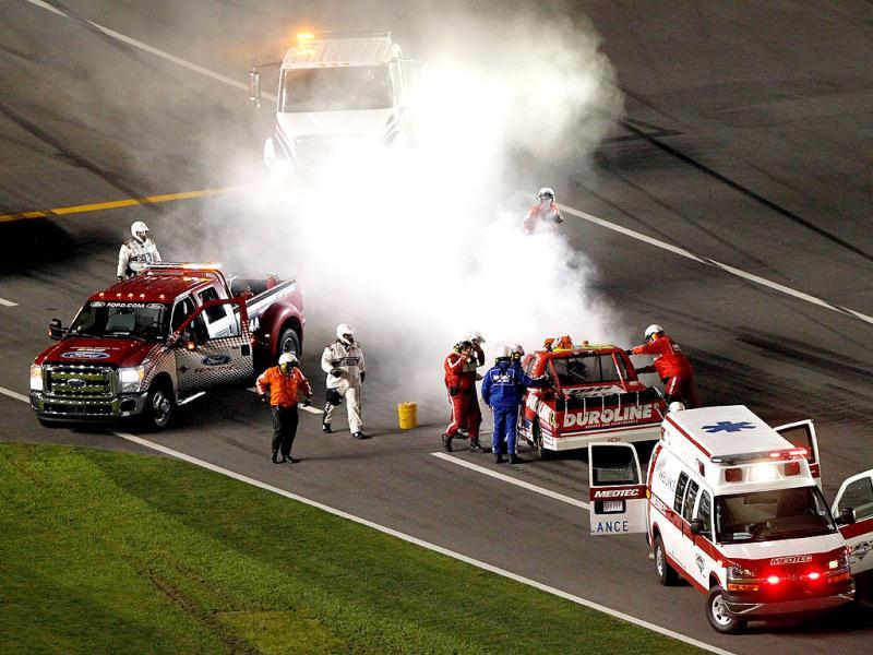 Safety workers tend to Miguel Paludo, driver of the #32 Duroline Brakes and Components Chevrolet, after hitting the wall during the NASCAR Camping World Truck Series NextEra Energy Resources 250 at Daytona International Speedway in Daytona Beach, Florida. (AFP Photo)