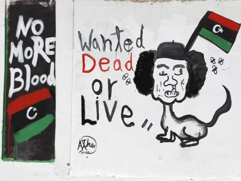 A caricature depicting Muammar Gaddafi is seen in Tripoli. (Reuters/Zohra Bensemra)