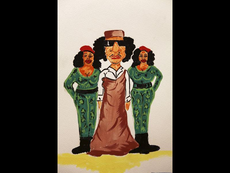 A caricature depicting former Libyan leader Muammar Gaddafi with female bodyguards is displayed in a gallery at an exhibition titled