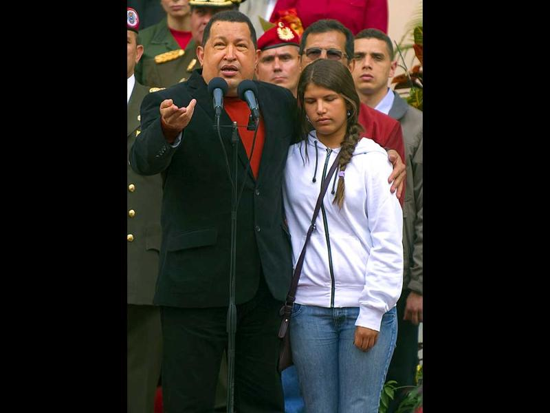 Venezuela's President Hugo Chavez (L) delivers a speech accompanied by his daughter Rosa Ines (R) before his departure for Cuba, for further cancer treatment.AFP PHOTO/Juan Barreto
