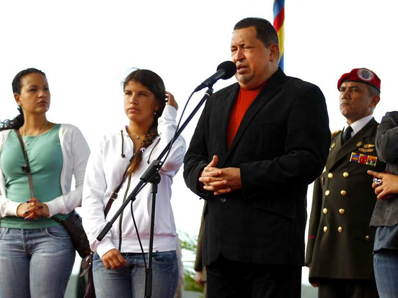Venezuela President Hugo Chavez talks to the media, accompanied by his daughters Rosa (L), Ines (2nd L) and Maria (R) before his departure to Cuba, in Caracas. Reuters/Jorge Silva