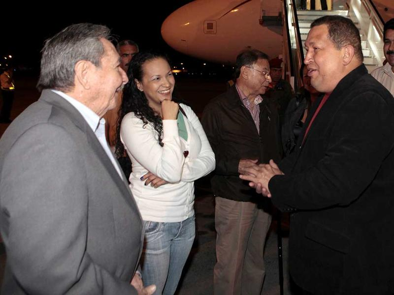 Venezuela President Hugo Chavez, right, accompanied by one of his daughters, Rosa, second from left, is welcomed by Cuba's President Raul Castro, left, upon his arrival to Havana, Cuba. Chavez is in Cuba for urgent surgery to remove a tumor he says is probably malignant. (AP Photo/Marcelo Garcia)