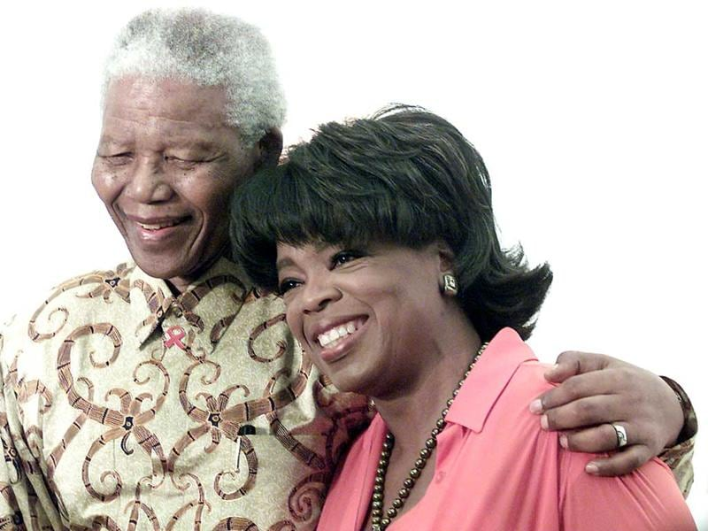 US talk show personality Oprah Winfrey with former South African president Nelson Mandela during the Agenda for Earth Turning Ceremony for The Oprah Winfrey Leadership Academy for Girls in South Africa in Henley on Klip south of Johannesburg. (Reuters file photo)