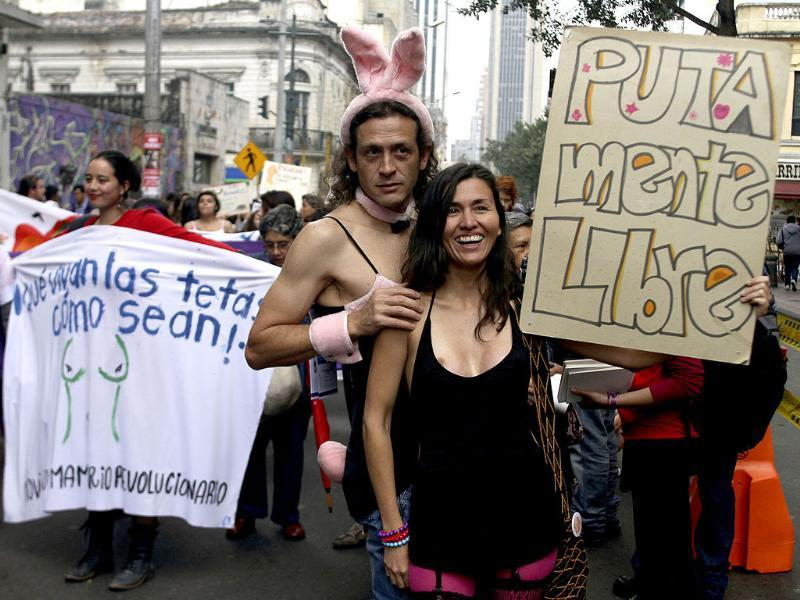 Members of the Network of Women take part in a 'March of the whores' to protest against discrimination and violence against women in Bogota. The poster reads: Free whore mind. REUTERS/Fredy Builes