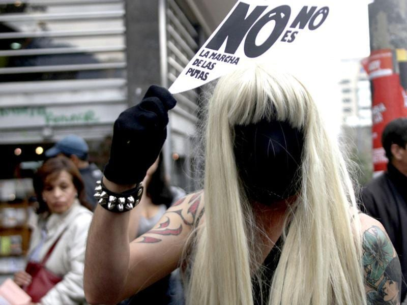 A man in a wig and mask takes part in a 'March of the whores' to protest against discrimination and violence against women in Bogota. Reuters/Fredy Builes