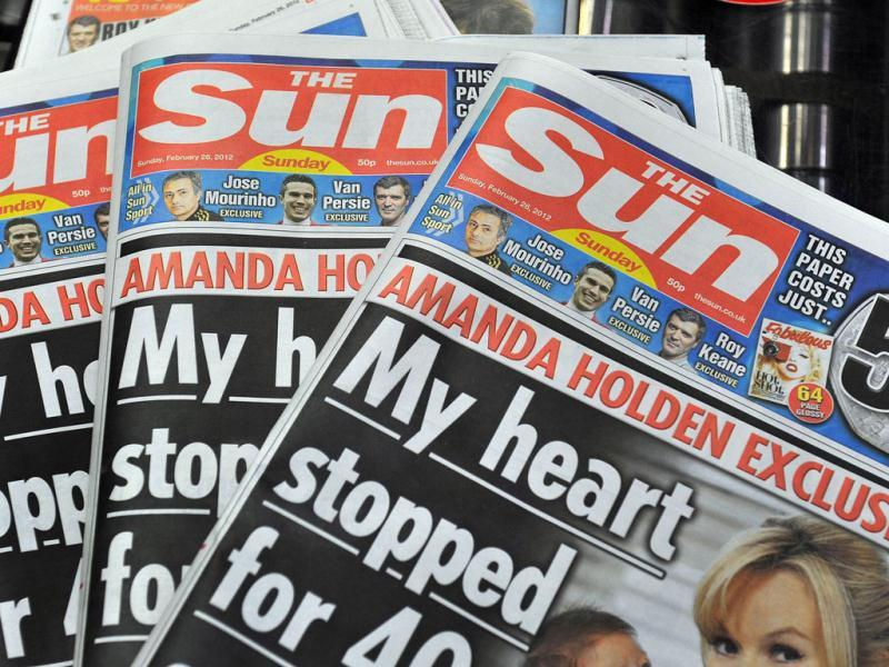 First copies of the new The Sun on Sunday are displayed at the News Printers plant in Broxbourne, outside London. The chairman and chief executive officer of News Corporation, Rupert Murdoch, said he wanted the paper replacing the scandal-hit News of the World to sell over two million copies. (AFP Photo)