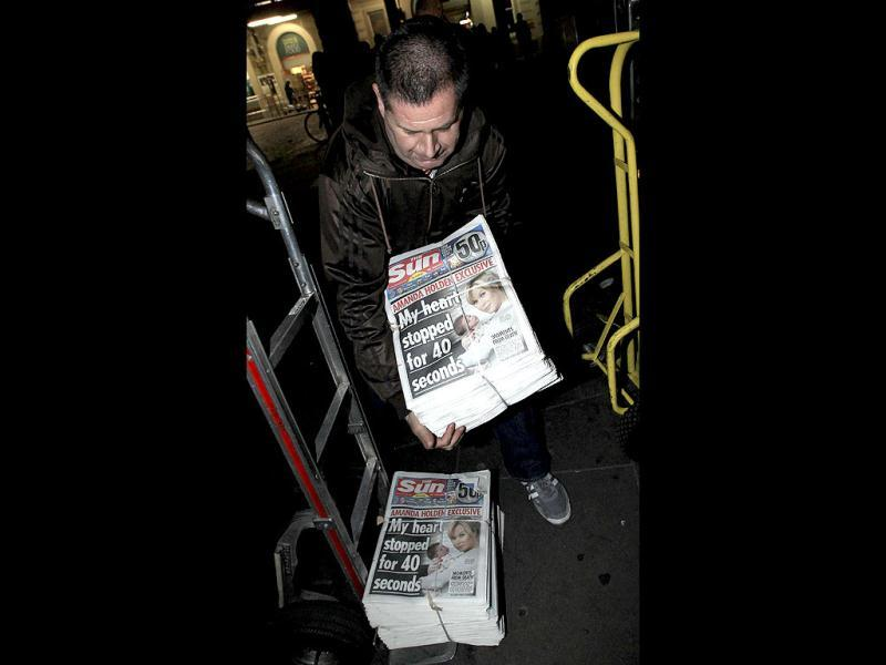 A newspaper seller unloads copies of the first edition of The Sun on Sunday for sale at Charring Cross station in London. The launch of the new newspaper follows last year's closure of the News of the World, amid the scandal over phone hacking. (Reuters)
