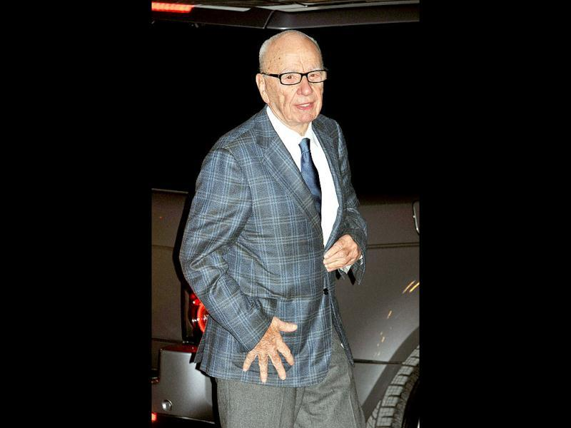 Chairman and chief executive officer of News Corporation, Rupert Murdoch, arrives to see the first copies of the new edition of The Sun on Sunday at the News Printers plant in Broxbourne, outside London. (AFP Photo)