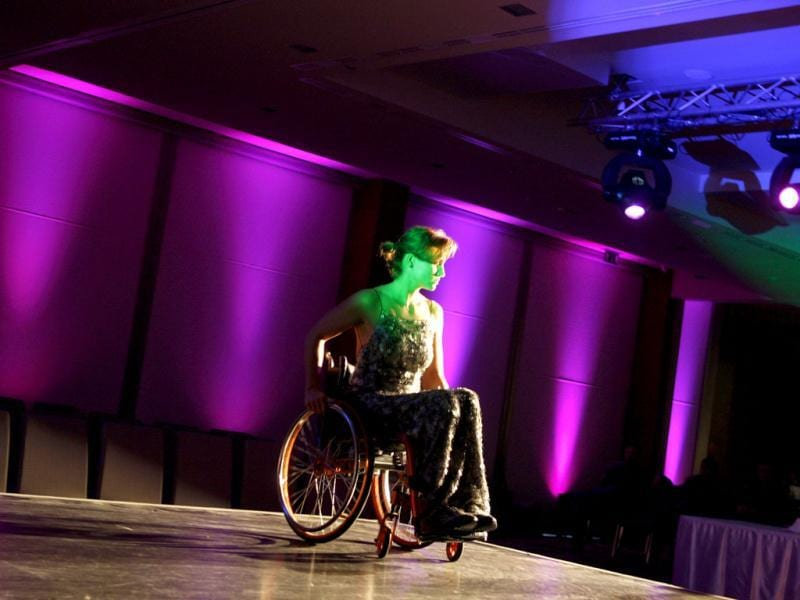 A competitor practices on the stage at the Miss Colours Hungary, the country's first wheelchair beauty contest, in Budapest. (Reuters/Bernadett Szabo)