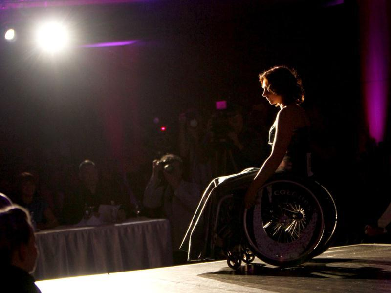 A competitor poses on stage during the Miss Colours Hungary, the country's first wheelchair beauty contest, in Budapest. (Reuters/Bernadett Szabo)