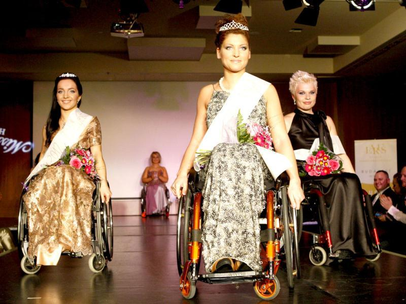 Second-placed Edina Melnyik (L), first-placed Katalin Eszter Varga (C) and third-placed Marietta Laura Molnar (R) pose after the Miss Colours Hungary, the country's first wheelchair beauty contest, in Budapest. (Reuters/Bernadett Szabo)