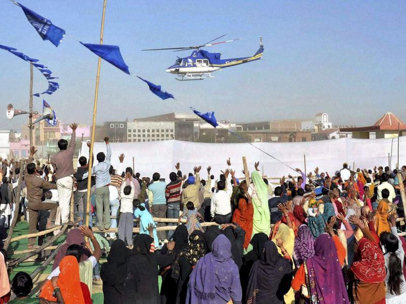 Uttar Pradesh chief minister and Bahujan Samaj Party (BSP) chief Mayawati leaves in a helicopter after attending an election rally in Moradabad. PTI Photo