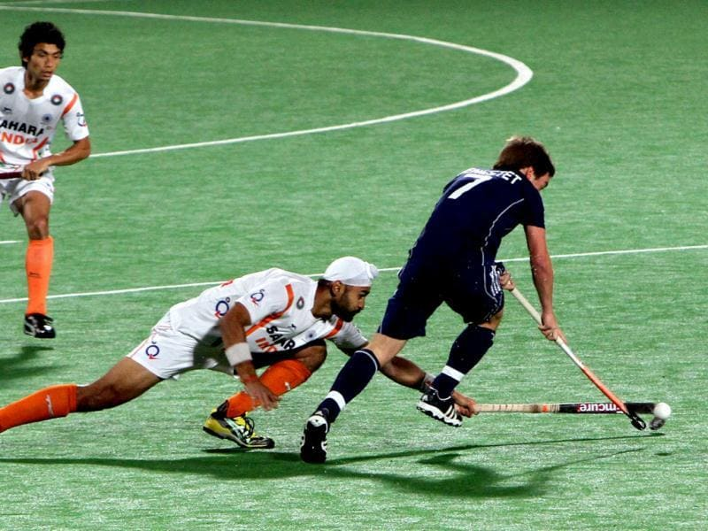 Sandeep Singh tries for the ball during India-France men's hockey Olympic qualifying match at National Stadium in New Delhi. HT Photo/Mohd Zakir