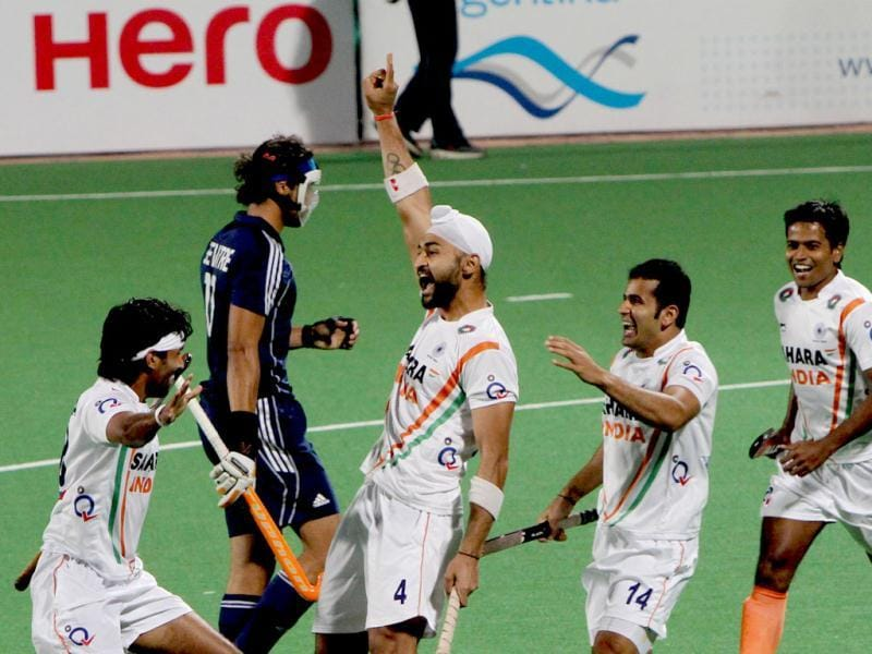Sandeep Singh celebrates with team members after scoring a goal against France during the Olympic qualifying men's hockey match in New Delhi. HT Photo/Mohd Zakir