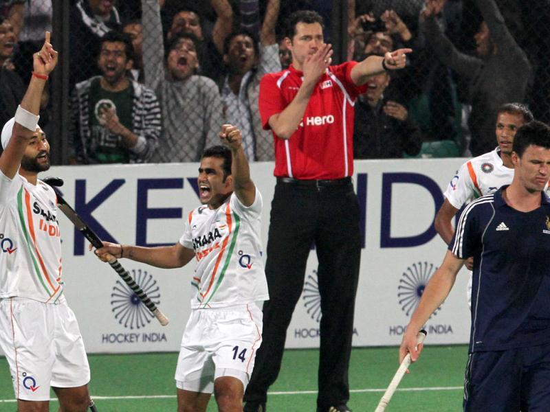 Sandeep Singh celebrates with Tushar Khandker as France captain Arnaud Becuwe (right) reacts after scoring goal against France during the Olympic qualifying men's hockey match in New Delhi. HT Photo/Mohd Zakir