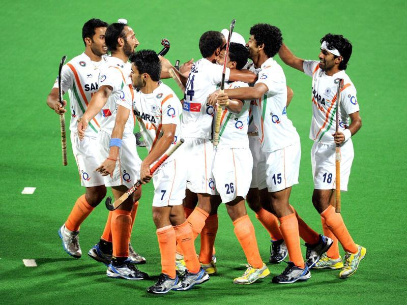 Indian players celebrate a goal against France during the Olympic qualifying men's hockey match in New Delhi. AFP Photo/Prakash Singh
