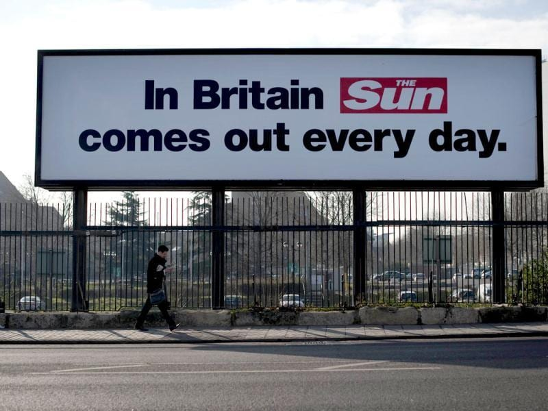 A Billboards outside the News International buildings in Wapping advertises 'The Sun on Sunday' in London. (AFP photo/Ben Stansall)