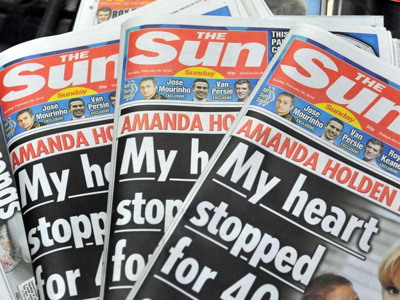 First copies of 'The Sun on Sunday' are displayed at the News Printers plant in Broxbourne, outside London. (AFP photo/John Stillwell)