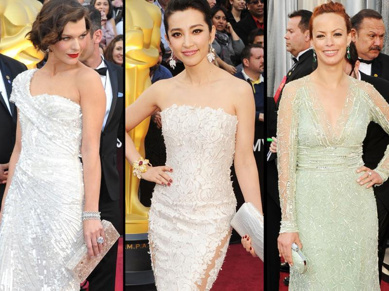 From Left to right: Milla Jovovich, Bingbing Li and Berenice Bejo arrive on the red carpet for the 84th Annual Academy Awards.