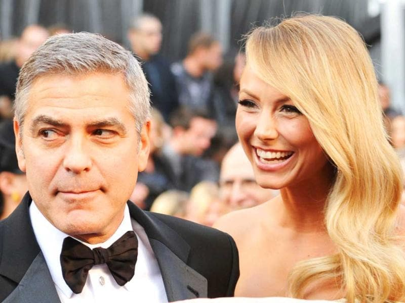 Actor George Clooney and Stacy Kiebler arrive at the 84th Annual Academy Awards held at the Hollywood Highland Center. (AFP)