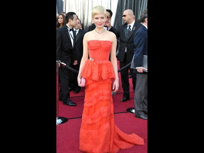 Actress Michelle Williams arrives on the red carpet for the 84th Annual Academy Awards. (AFP)
