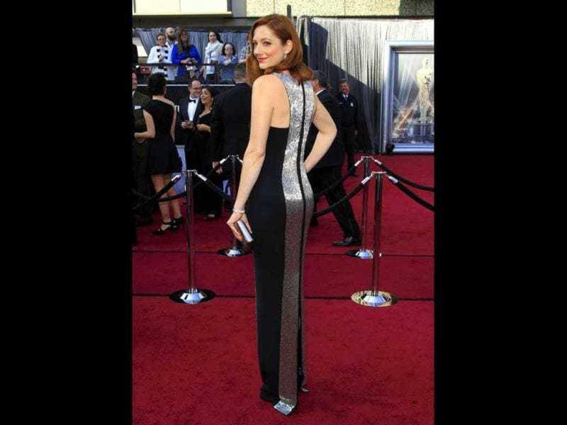 Actress Judy Greer, from the film The Descendants, poses as she arrives at the 84th Academy Awards.