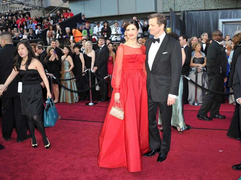 Actor Colin Firth (R) and Livia Giuggioli arrive on the red carpet for the 84th Annual Academy Awards. (AFP)
