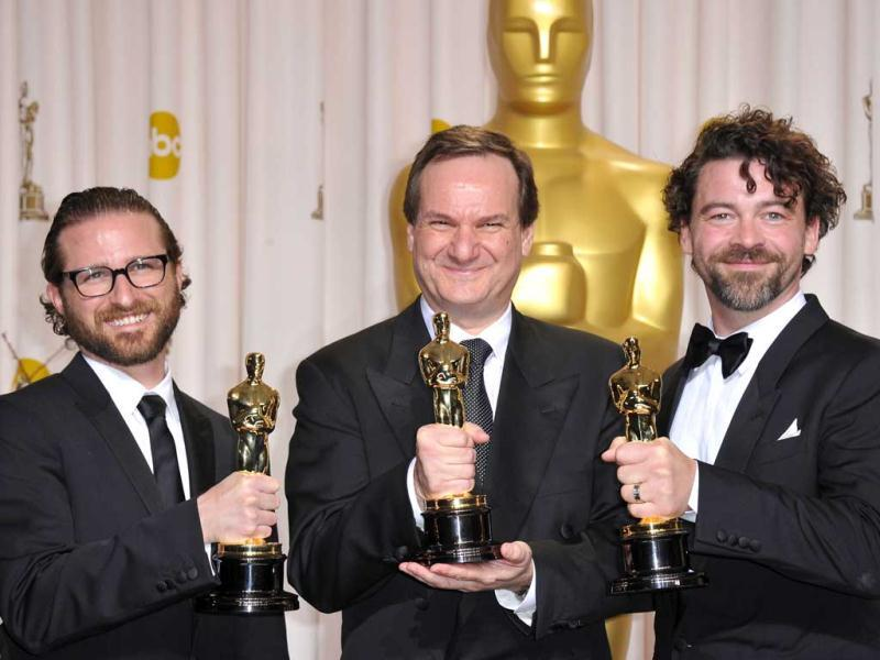 Winners for Best Visual Effects in Hugo, Rob Legato, Ben Grossman and Alex Henning hold their trophies in the press room at the 84th Annual Academy Awards. (AFP)