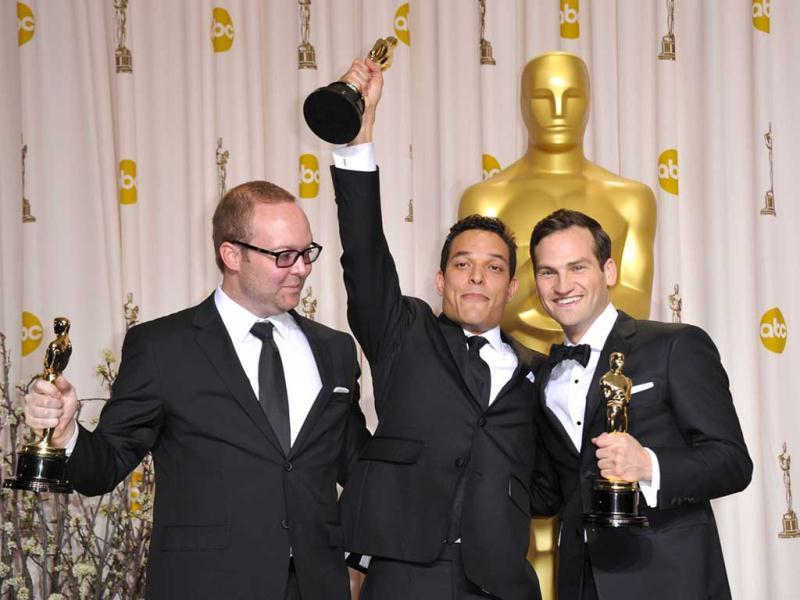 Winners for Best Documentary Feature Undefeated, TJ Martin, Dan Lindsay and Rich Middlemas hold their trophies in the press room at the 84th Annual Academy Awards. (AFP)
