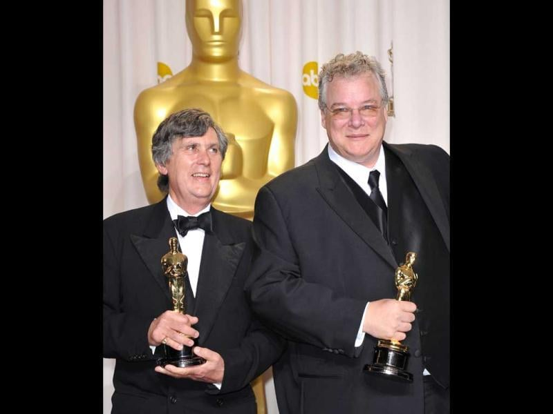 Winners for Best Sound Mixing in Hugo, Tom Fleischman and John Midgley hold their trophies in the press room at the 84th Annual Academy Awards. (AFP)