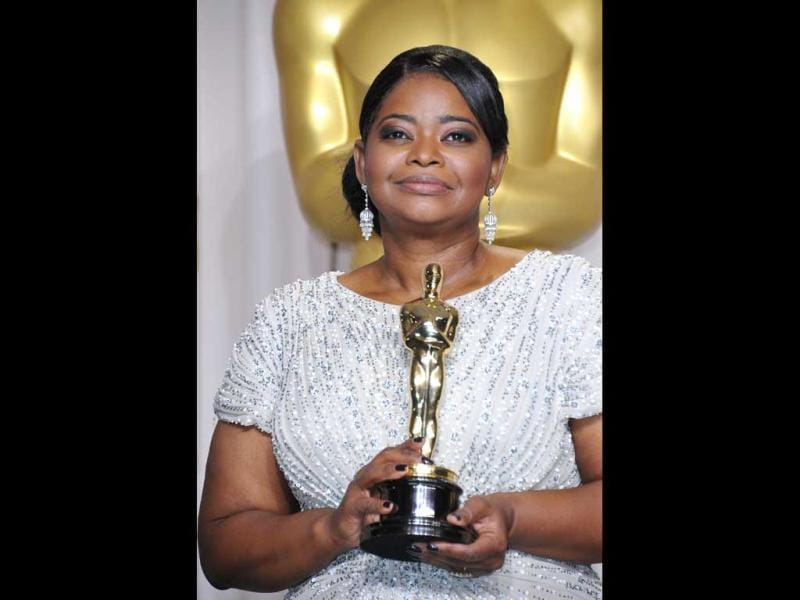 Winner for Best Actress in a Supporting Role for The Help Octavia Spencer holds the trophy in the press room at the 84th Annual Academy Awards. (AFP)