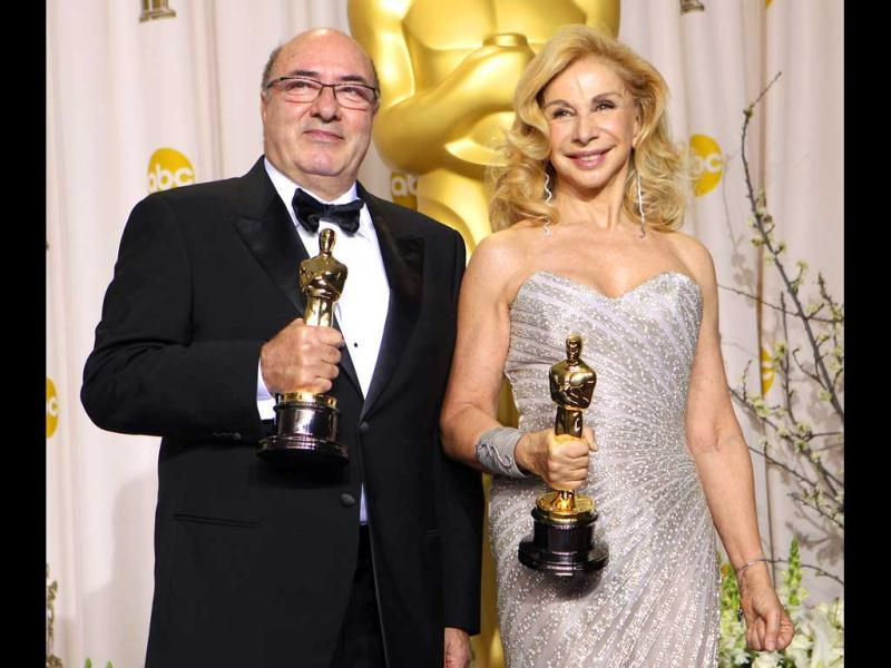 Dante Ferretti, left, poses with co-winner Francesca Lo Schiavo after the pair won the award for best art direction for Hugo during the 84th Academy Awards. (AP)