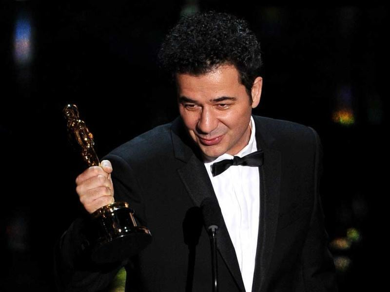 Oscar winner for Original Music Score Ludovic Bource for The Artist addresses the audience onstage at the 84th Annual Academy Awards. (AFP)