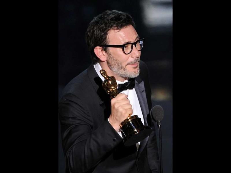 Winner for Best Director for The Artist Michel Hazanavicius accepts his trophy onstage at the 84th Annual Academy Awards.