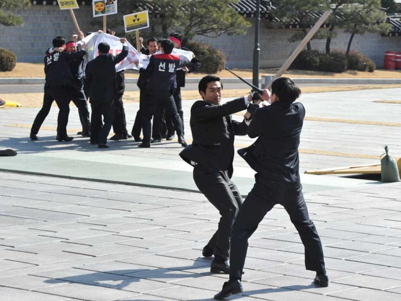 South Korean presidential body guards show martial art skills during an anti-terror drill at the president's residence, showcasing security preparations for an upcoming nuclear summit in Seoul. AFP Photo/Kim Jae-Hwan.