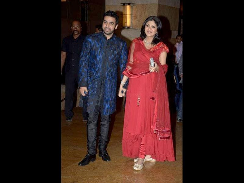 Shilpa and Raj walk hand in hand.